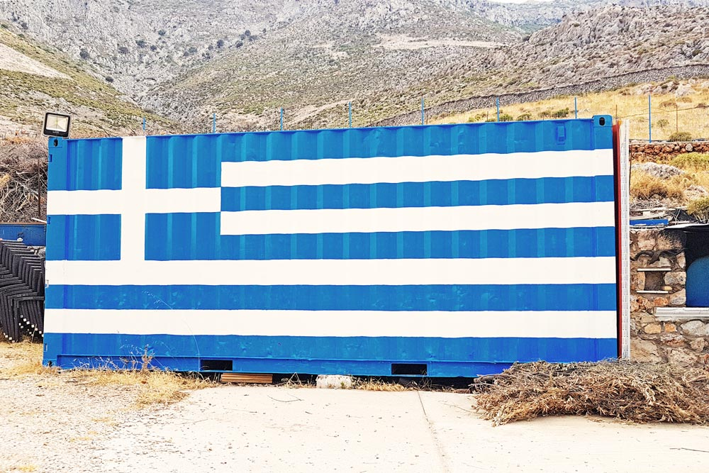 The big Greek flag at painted on a container next to Kalidonis restaurant