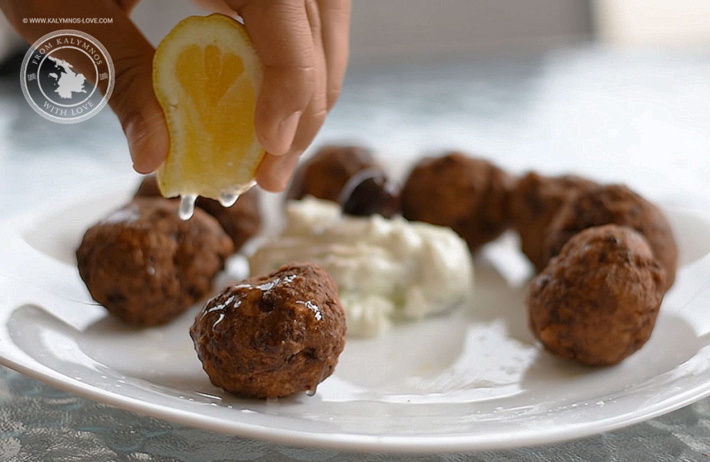 Xtapodokeftedes (octopus meatballs) drizzled with lemon