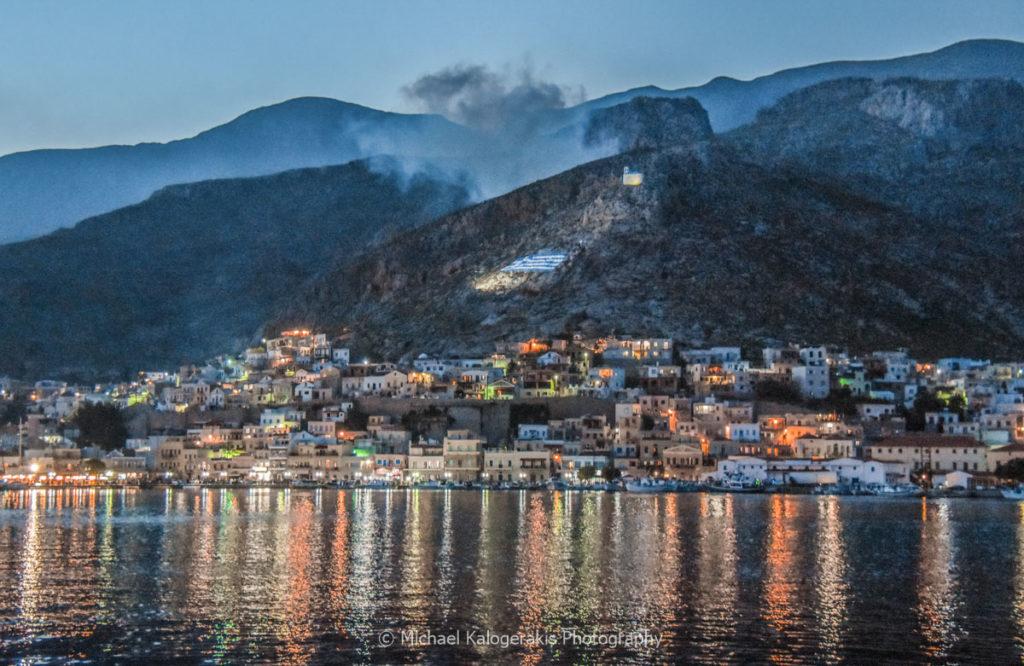 Pothia Kalymnos by night, seeing dynamite smoke in the mountain